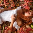 Red-haired young woman, wearing in white dress or the bride — Stock Photo