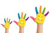 Drie kleurrijke handen met glimlach van familie — Stockfoto