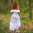 Bride go to the forest, view from the back. The rear view. — Foto de Stock