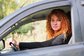 Woman driving car — Stock Photo