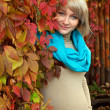 Autumn portrait a lovely young gray-eyed blond pregnant woman — Stock Photo #13667609