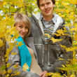 Stock Photo: Love beautiful young pregnant couple in the autumn forest
