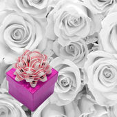 Purple gift with a bow on a background of white roses. — Stock Photo