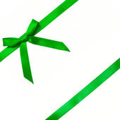 Green satin bow on a satin ribbon. — Stock Photo