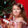 Little girl waiting for miracle under the Christmas tree — Stock Photo #13824924