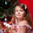 Little girl waiting for miracle under the Christmas tree — Stock Photo