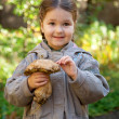 Little girl holding boletus — ストック写真