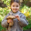 Little girl holding boletus — Stockfoto