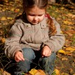 Little girl holding boletus — Stock Photo