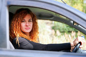 Young red-haired woman driving — Stock Photo