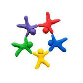 Concetto di lavoro di squadra, fatta di argilla colorata. pronti per il vostro testo o logo. — Foto Stock