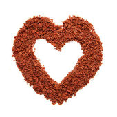 Frame with heart-shaped, formed from grated dark chocolate — Stock Photo