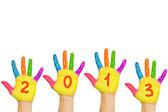 Los niños las manos formando número 2013 — Foto de Stock