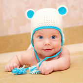 Smiling baby with blue eyes — Stock Photo