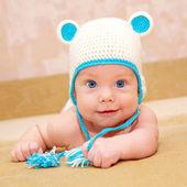 Usměvavý miminko s modrýma očima — Stock fotografie