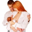 Happy family, father mother and baby. Mom breast feeding newborn — Stock Photo #15393017