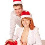Happy family in Santa Claus hats. Homemade Christmas — Stock Photo