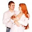 Happy family, father mother and newborn baby together. — Stock Photo #15649235