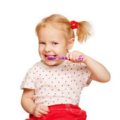 Pretty little girl brushing teeth. — Stock Photo