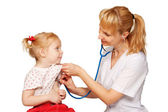 Doctor pediatrician listening to the child's heart — Stock Photo