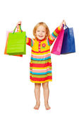 Little beautiful blond girl with shopping bags — Stock Photo