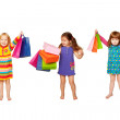 Little fashion girls with shopping bags — Stock Photo #16038927