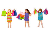 Little fashion girls with shopping bags — Stock Photo
