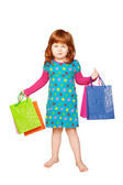 The red-haired child with shopping bags — Foto de Stock
