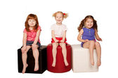 Happy little children sitting and laughing. — Stock Photo