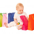 Baby shopping. Happy kid with shopping bags. — Stock Photo #17136569