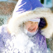 Happy smiling child and flying in his face snow — Stock Photo