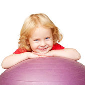 Happy child with fitness ball playing sports. — Stock Photo