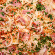 Pizza with ham, onions, cheese and herbs — Stock Photo