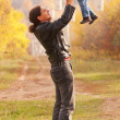 Happy father and baby outdoors. — Stock Photo
