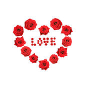"Valentine heart made ​​of roses with the word ""love"" — Stock Photo"