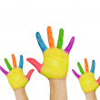 Painted hands raised up. Groups of children in classroom. — Stock Photo