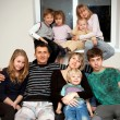 Stock Photo: Father, mother and seven children at home.