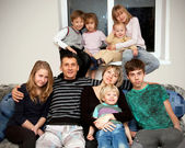 Father, mother and seven children at home. — Stock Photo