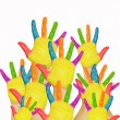 Royalty-Free Stock Photo: Many painted children\'s hands raised up.