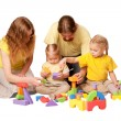 Happy family building from toy blocks — Stock Photo