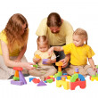 Happy family building from toy blocks — Stock Photo #20416763