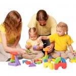 Happy family building from toy blocks — Stock Photo