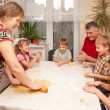 Happy big family cooking a pie together. — Stock Photo