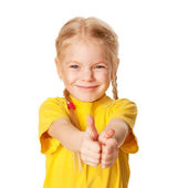 Smiling girl showing thumbs up or OK symbol. — Stock Photo