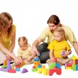 Happy father, mother and two children building — Stock Photo