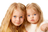 Two lovely sisters. Preschooler and baby girl. — Stock Photo