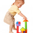 Baby girl building from toy blocks. — Stock Photo