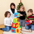 Family building with blocks at home. — Stock Photo