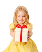 Pretty little girl giving gift. Festive concept. — Stock Photo