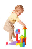 Baby girl building from toy blocks. — Photo